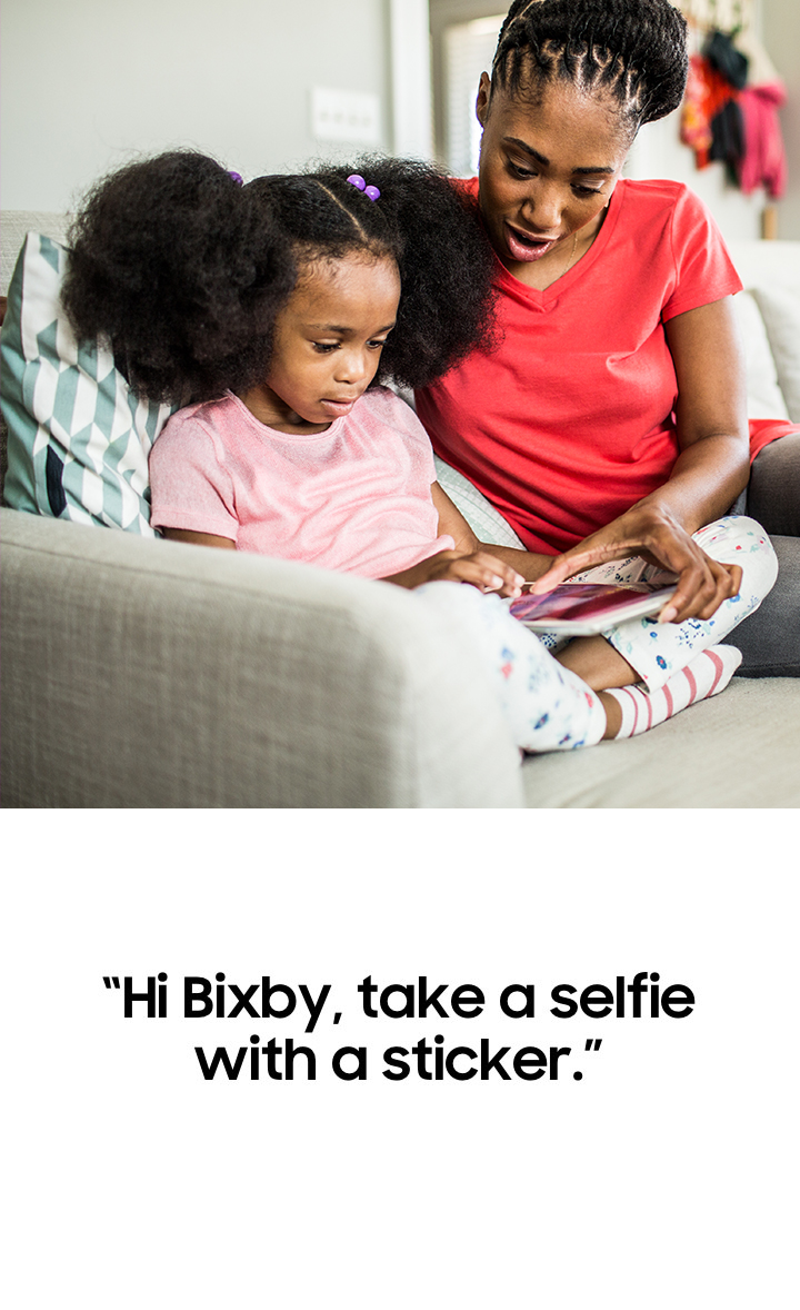 A screen in the Gallery app on a Galaxy phone showing photos with friends during a trip to Brooklyn after searching for 'Brooklyn trip images' using Bixby's Galaxy control features.