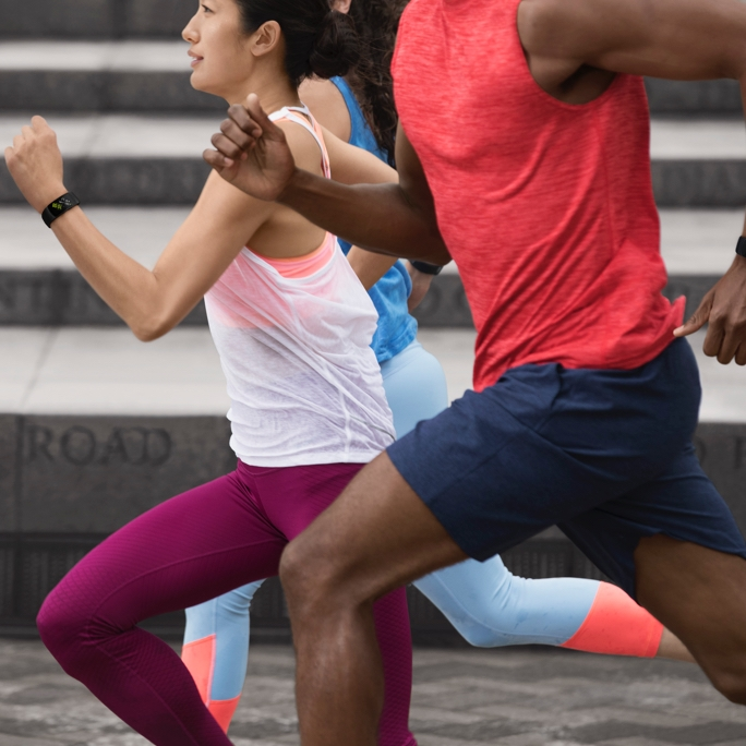A group of joggers run along their route while AI mixes their playlists for them based on information obtained from their wearables.