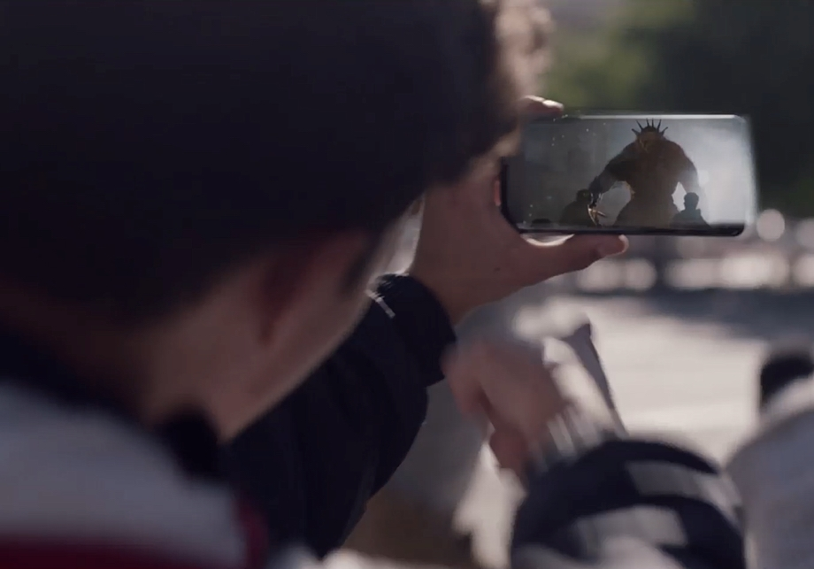 A gamer lines up his shot at a giant monster displayed via Augmented Reality on his Samsung Galaxy device.