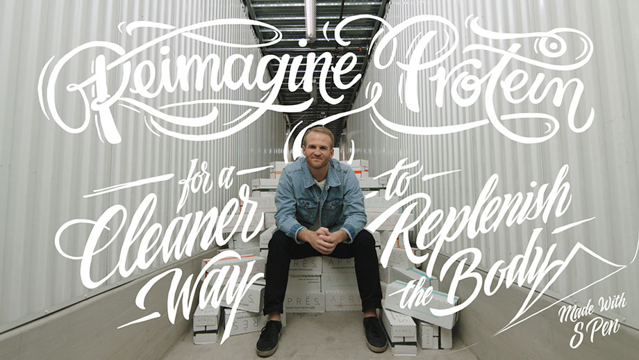 """The Co-Founder and CEO of Après, Sonny McCraken sits on a pile of boxes containing his product. There is handwriitten script overlayed on top of the photo that reads: """"Reimagine protein for a cleaner way to replenish the body. Made with S Pen""""."""