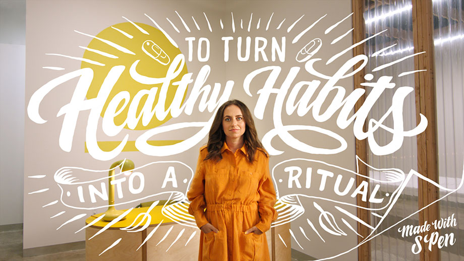 """The Founder and CEO of Ritual, Katerina Schneider standing with her hands in her pockets while facing the camera. There is handwriitten script overlayed on top of the photo and all around her which reads: """"To turn healthy habits into a ritual. Made with S Pen""""."""
