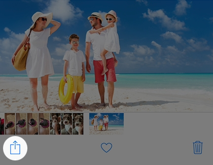 Image of family on the beach in the Photos app with Share, Like, and Delete icons below