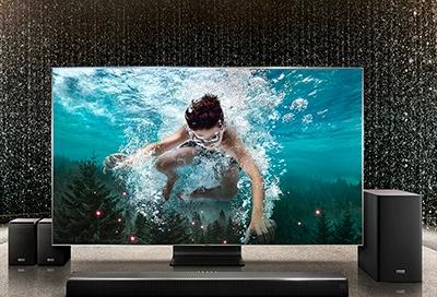 Samsung TV with surround sound speakers