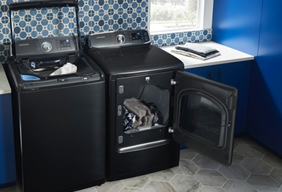 Open Samsung washer and dryer with clothes in them