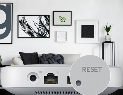 The Reset button highlighted on the SmartThings WiFi hub