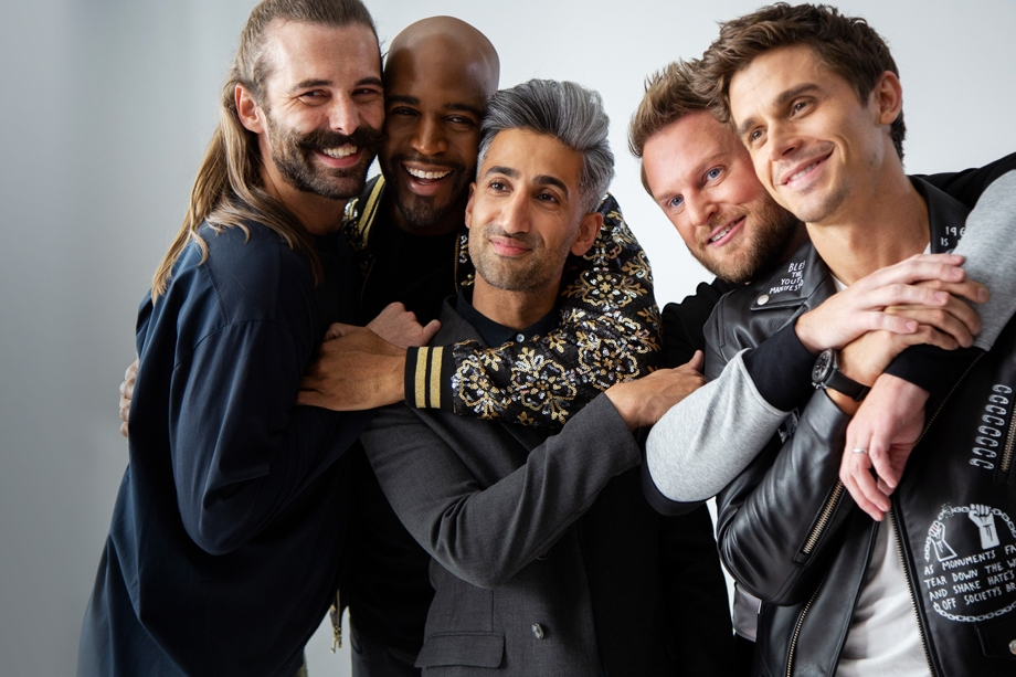 Scene from hit series Queer Eye via Netflix mobile app that shows the main cast smiling into the camera while hugging one another