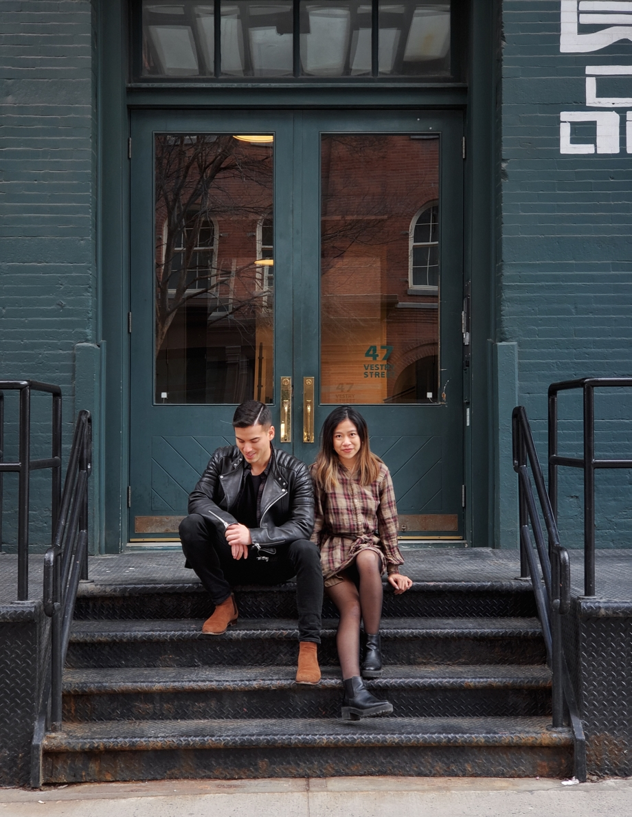 Photo of man and woman sitting on shop's stoop