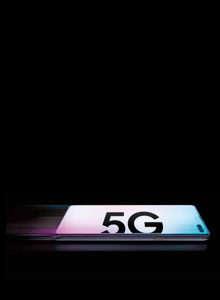 "A pastel blue and pink Samsung Galaxy S10 smartphone face-down with text that reads ""5G"" in bold typeface"