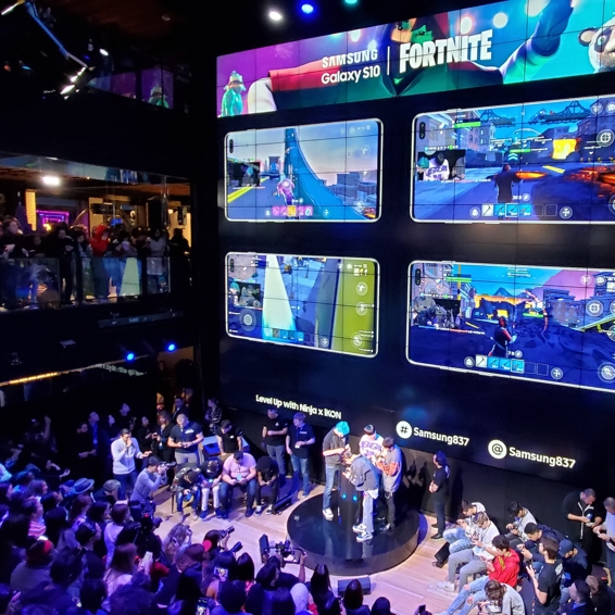 A crowd at Samsung 837 in New York City watches as Ninja, K-pop sensation iKON and other gamers battle it out in a unique Fortnite tournament