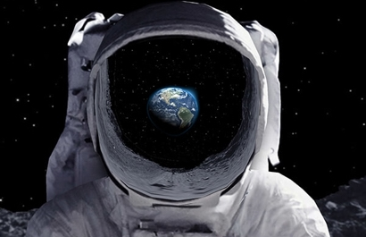 Astronaut in space looking at Earth