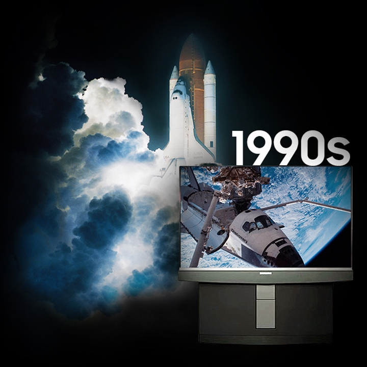 background image of a space shuttle lifting off. On the screen of a 1990's era television is an image of the shuttle Discovery with its hatch open.