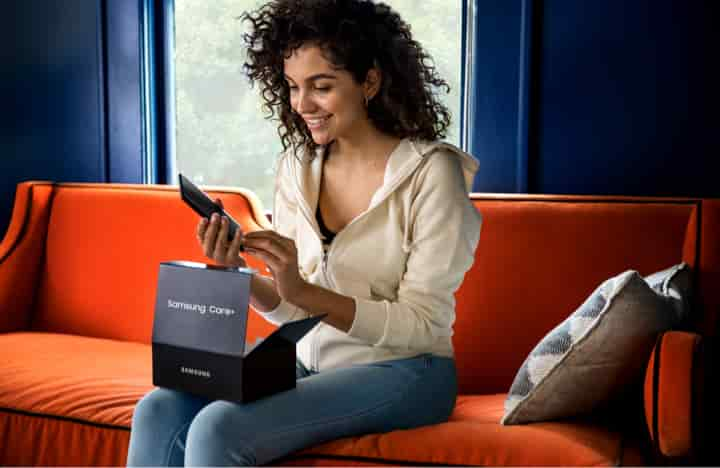 Woman opening Samsung Care+ package