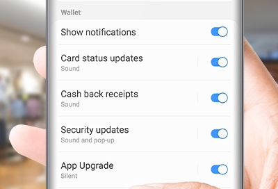 Person turning on cash back notifications on phone