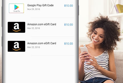 Woman smiling looking at her purchase history in Samsung Pay on her phone