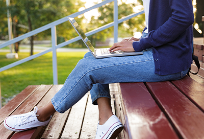 Person using Samsung Chromebook outdoors