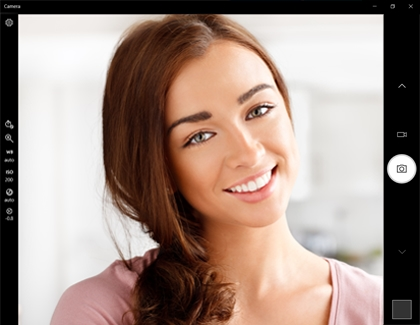 Camera options to the left and right of a woman smiling