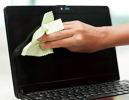 Hand cleaning a laptop screen
