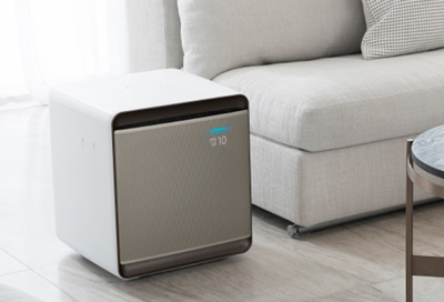 A Samsung Air Purifier next to a sofa