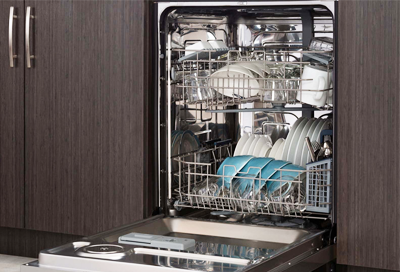 Loaded Samsung dishwasher with the door open