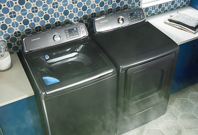 A dryer emitting smoke into a laundry room