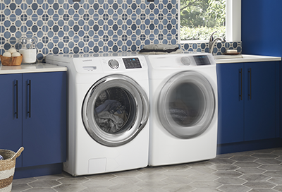 Samsung washer next to a dryer that is vibrating
