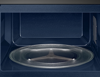 A turntable inside a blue microwave