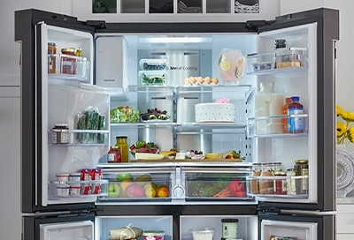 Opened Samsung fridge filled with neatly organized food