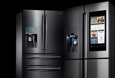 A Samsung Family Hub refrigerator and a 4-Door French Door Samsung refrigerator