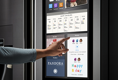 A Samsung Family Hub fridge panel displaying multiple apps