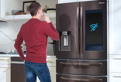Man looking at Family Hub fridge that won't connect to the internet