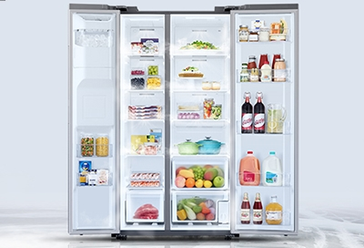 An open Samsung refrigerator filled with food