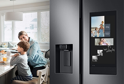 A Family Hub fridge with the different widgets displayed