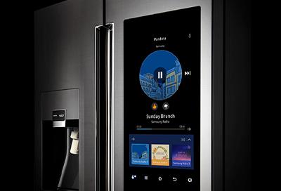 Refrigerator with screen displaying Pandora