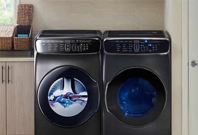 A Samsung washing machine next to a Samsung dryer