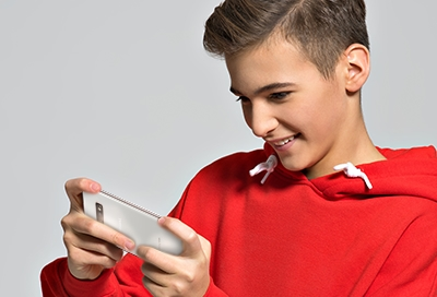 Boy in red hoodie playing game on his phone