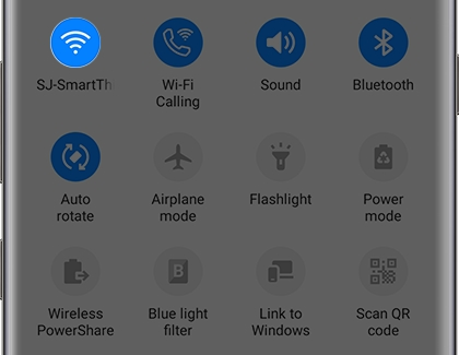 Quick Settings panel with the Wifi icon highlighted