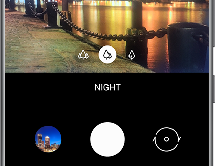 NIGHT selected in the Camera app with a nighttime scene in the background