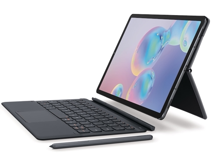 A Galaxy Tab S6 being placed on the keyboard attachment