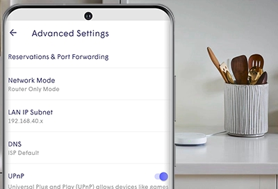 SmartThings Hub in the kitchen with a phone displaying Advanced settings