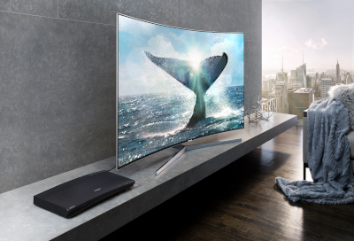 Image of a Samsung Blu-ray player next to a TV showing a whale diving underwater