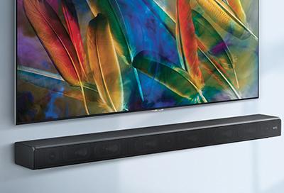 A Samsung Soundbar mounted below a TV