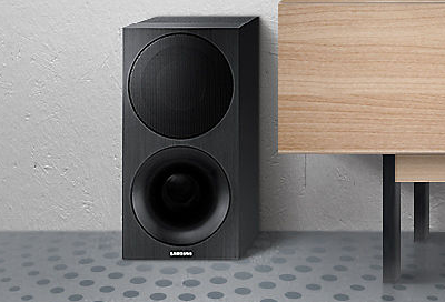 Image of a wireless speaker next to a TV table