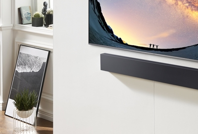 A soundbar connected to the TV with Bluetooth