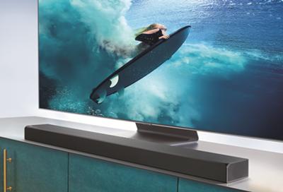 A Samsung TV with a soundbar
