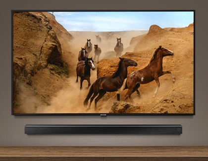 Horses in a desert scene on a Samsung TV with a soundbar