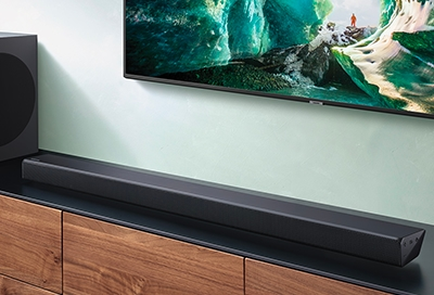 Samsung soundbar in front of Samsung TV