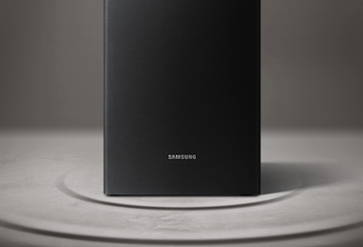 A Samsung subwoofer sitting on the floor