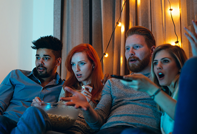 A group of men and women watching a Samsung TV