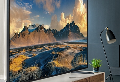 QLED TV displaying a picture of a canyon