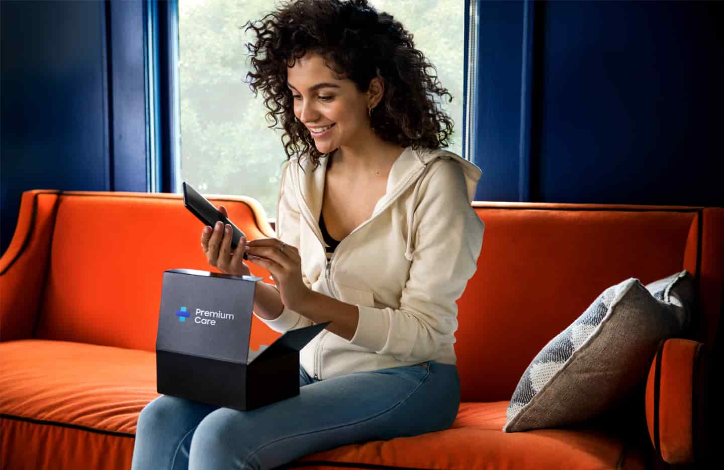 Woman opening Samsung Premium Care package